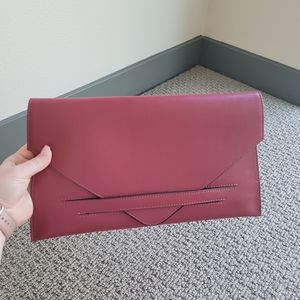 Maroon clutch with gold chain crossbody
